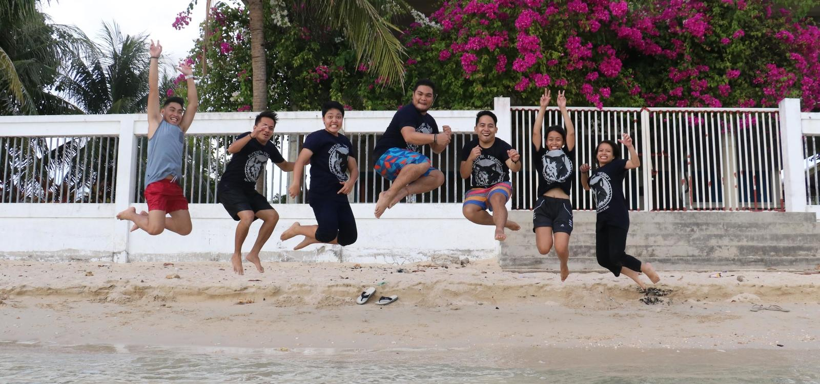 Projects Abroad volunteers having fun on a beach in the Philippines